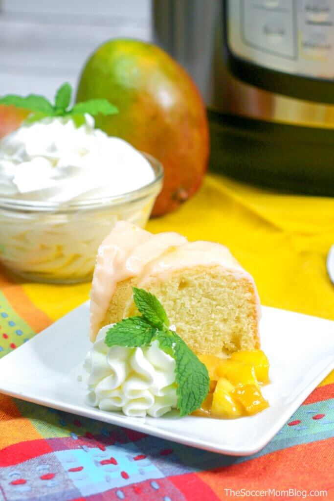 slice of mango bundt cake with Instant Pot in background