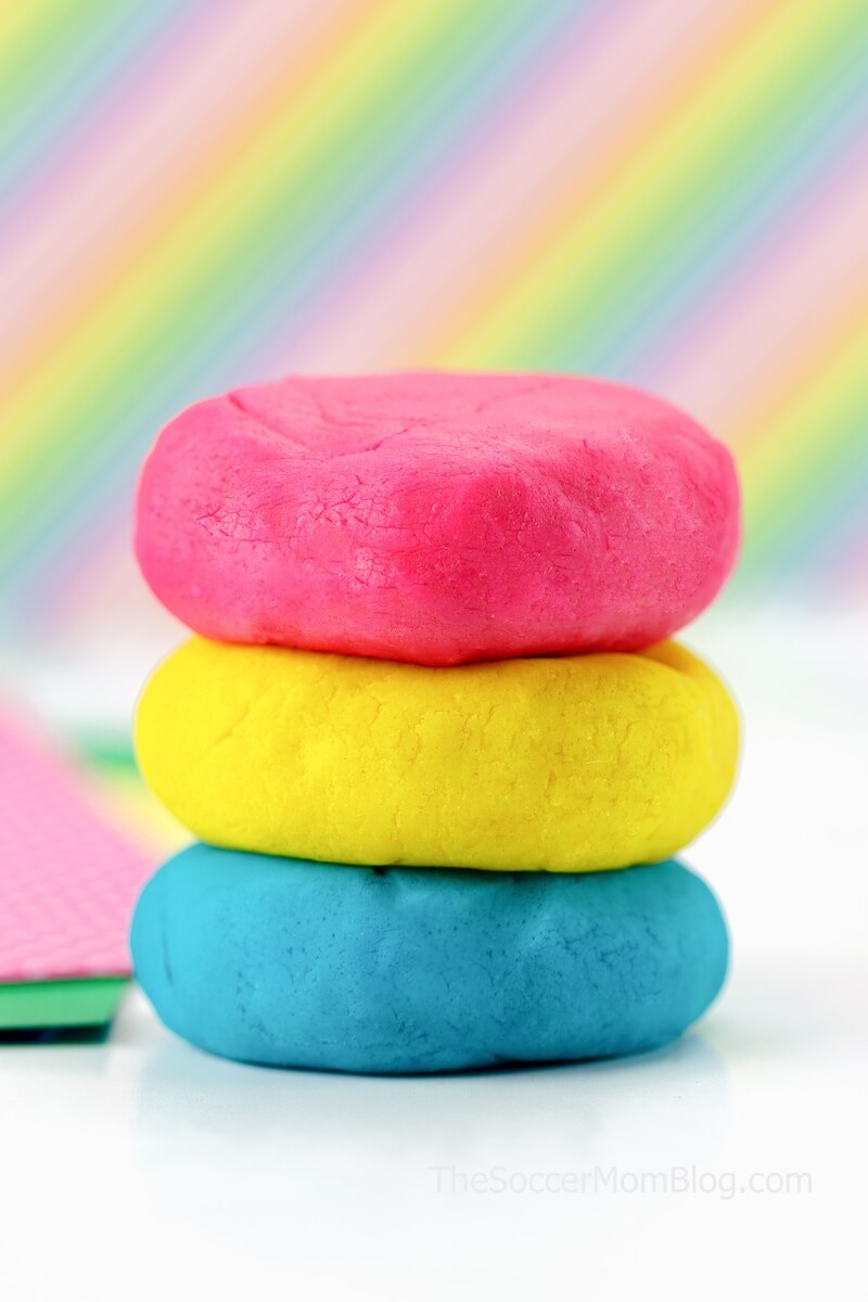 pink, yellow, and blue play dough with rainbow background