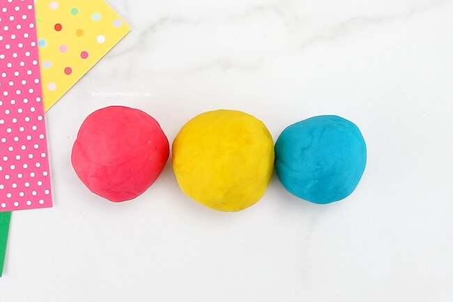 balls of red, yellow, and blue playdoh