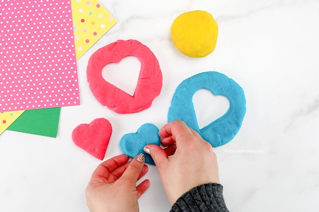 cutting shapes out of playdoh