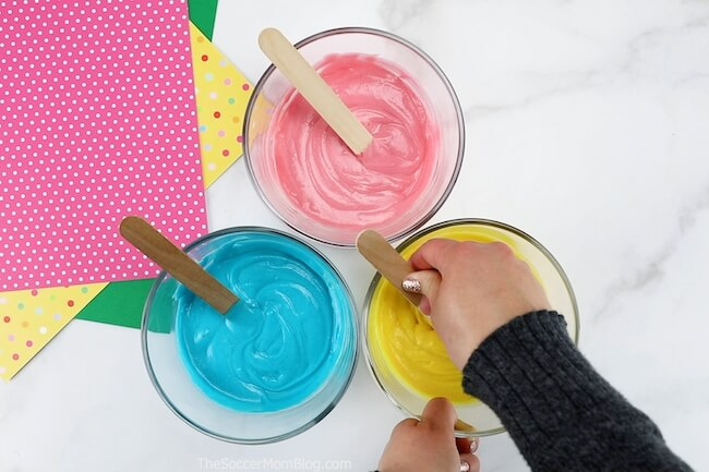 colorful play dough batter in mixing bowls