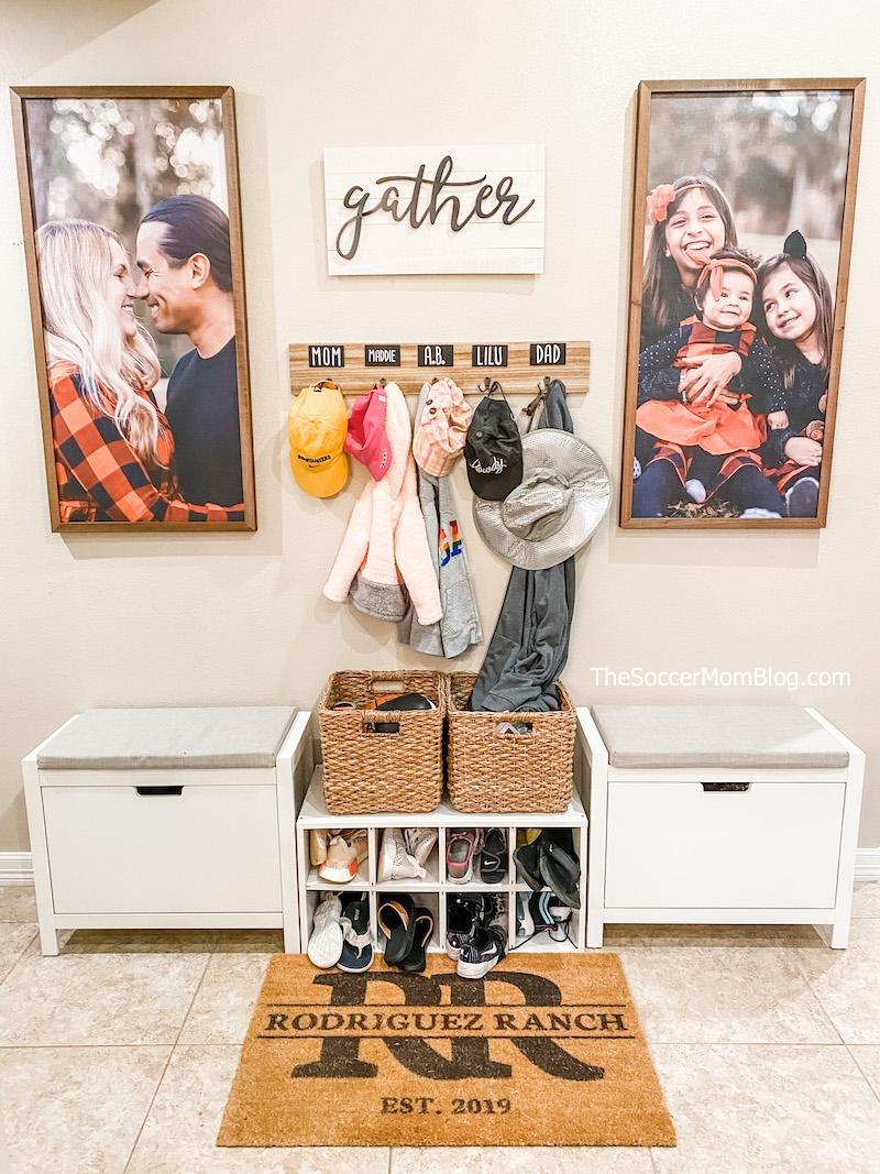 farmhouse style entryway with personalized coat rack and giant wood-framed family photos