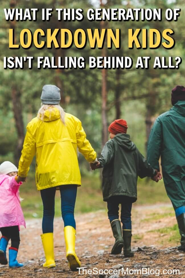 family walking in the woods in raincoats