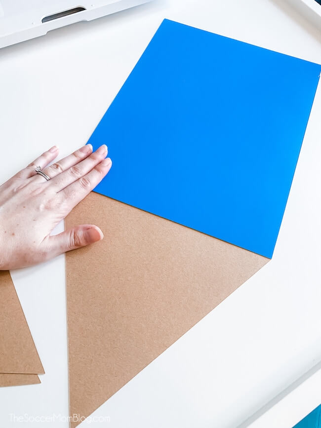 gluing together poster board craft