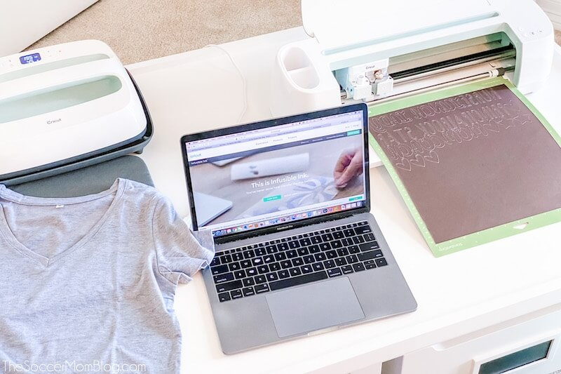 Cricut Maker, laptop, and EasyPress set up to make a t-shirt
