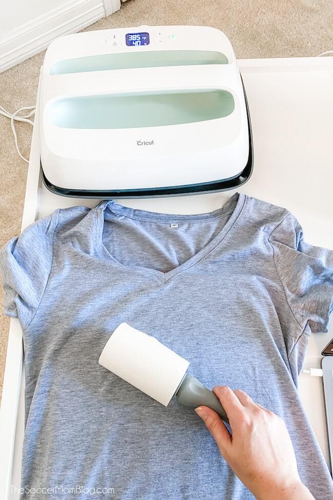 lint rolling a grey t-shirt