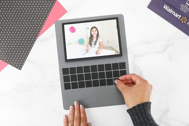 gluing black squares to make keys on a laptop card