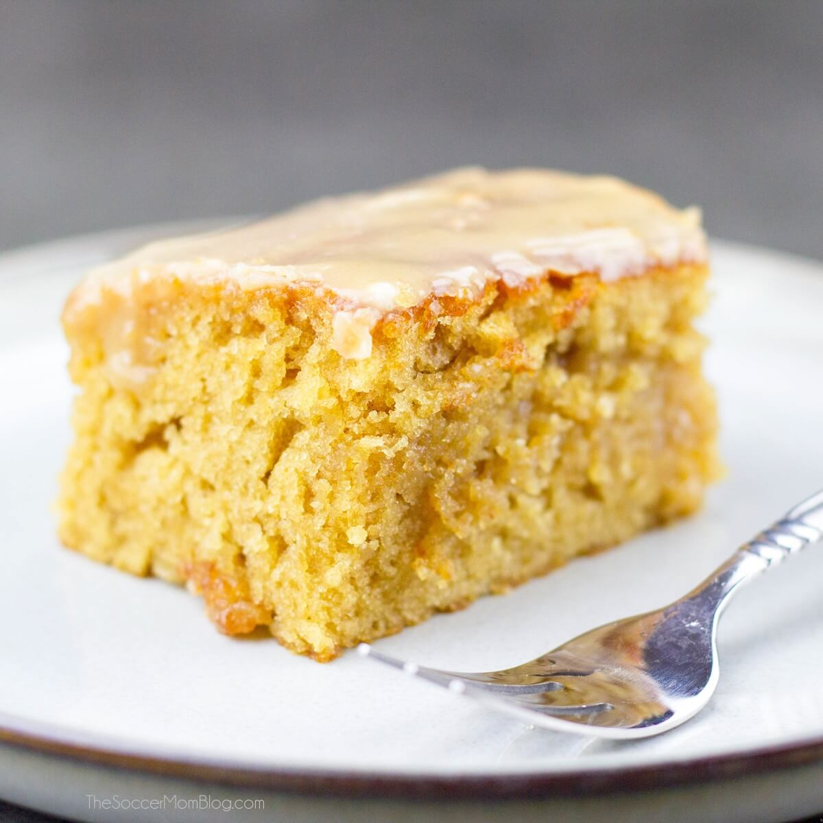 slice of peanut butter sheet cake with glaze