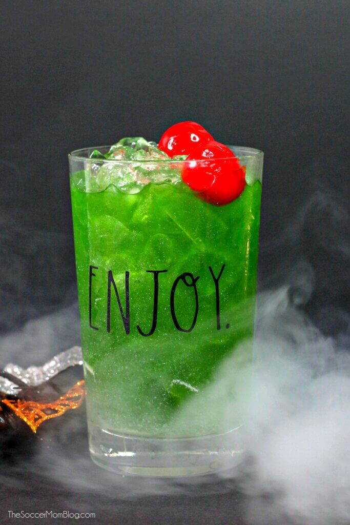 green witches brew cocktail for Halloween in pint glass