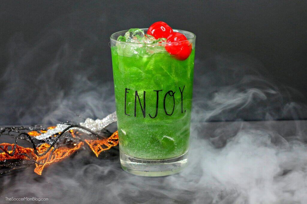 green Halloween cocktail surrounded by smoke