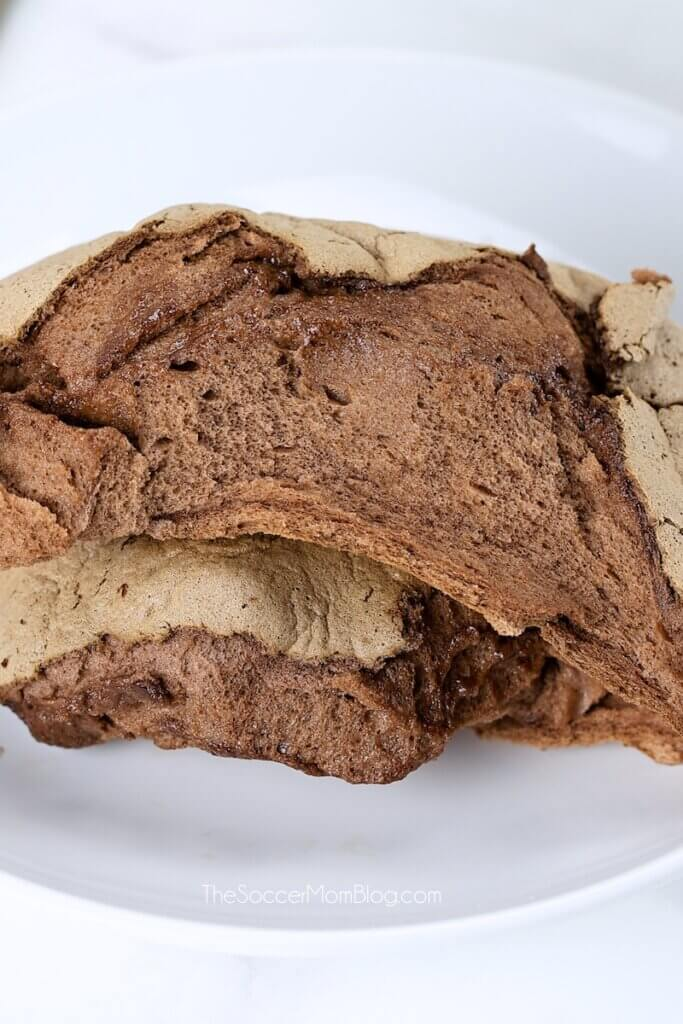 loaf of fluffy chocolate cloud bread torn in half to show the inside