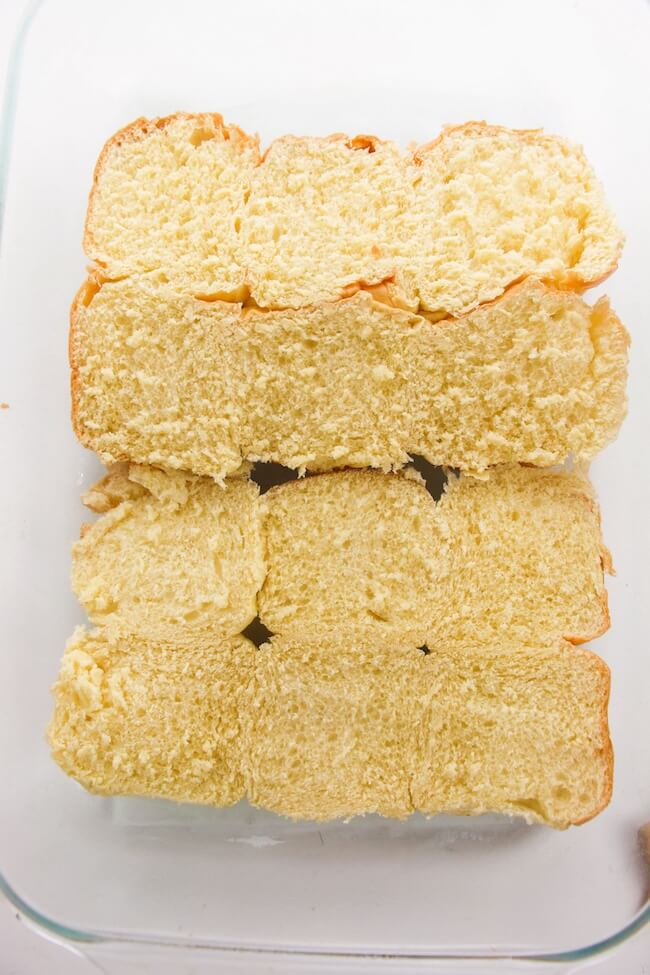 slider bread in the bottom of a glass baking dish