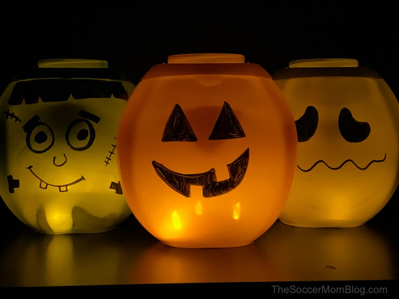 glowing DIY jack-o-lanterns made with empty laundry detergent containers
