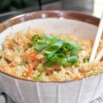 microwave fried rice in bowl with chopsticks