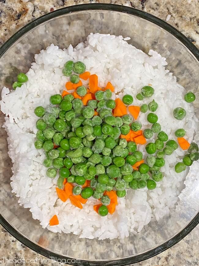 white rice, peas, and carrots in glass bowl