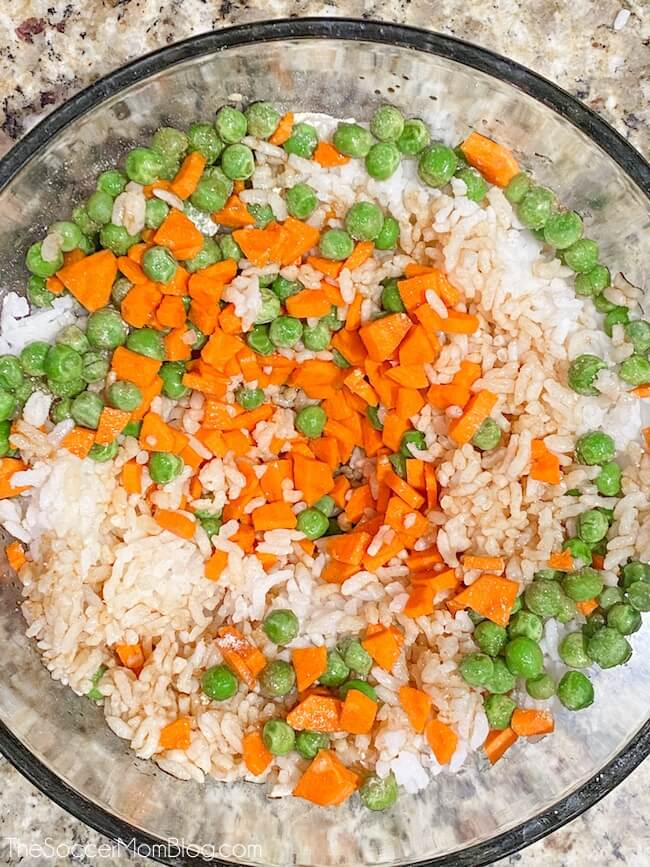 rice, peas, and carrots with soy sauce in bowl