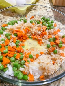 bowl of rice and veggies with scrambled egg in the middle