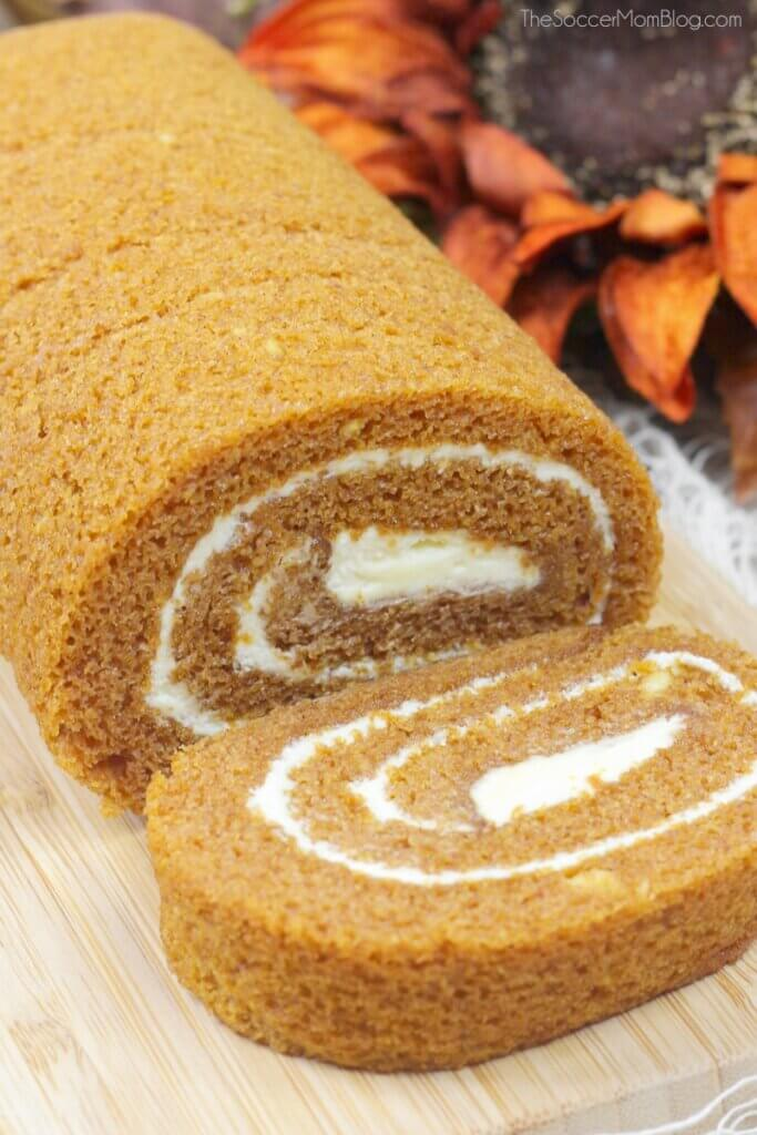 pumpkin cream cheese roll on cutting board