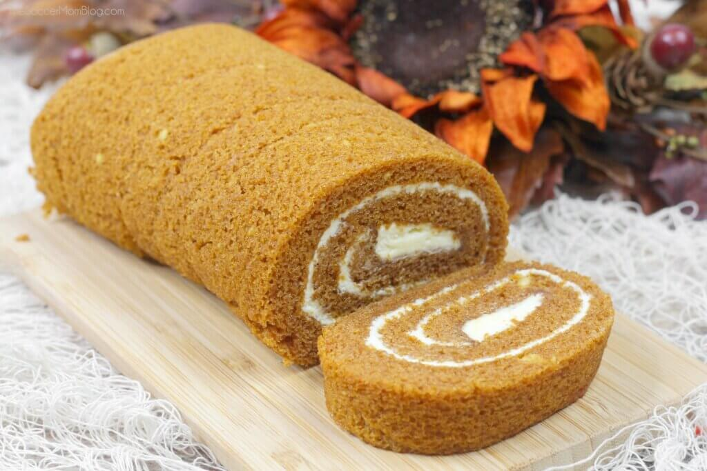 pumpkin roll sliced on cutting board