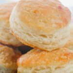 golden brown buttermilk biscuits on plate