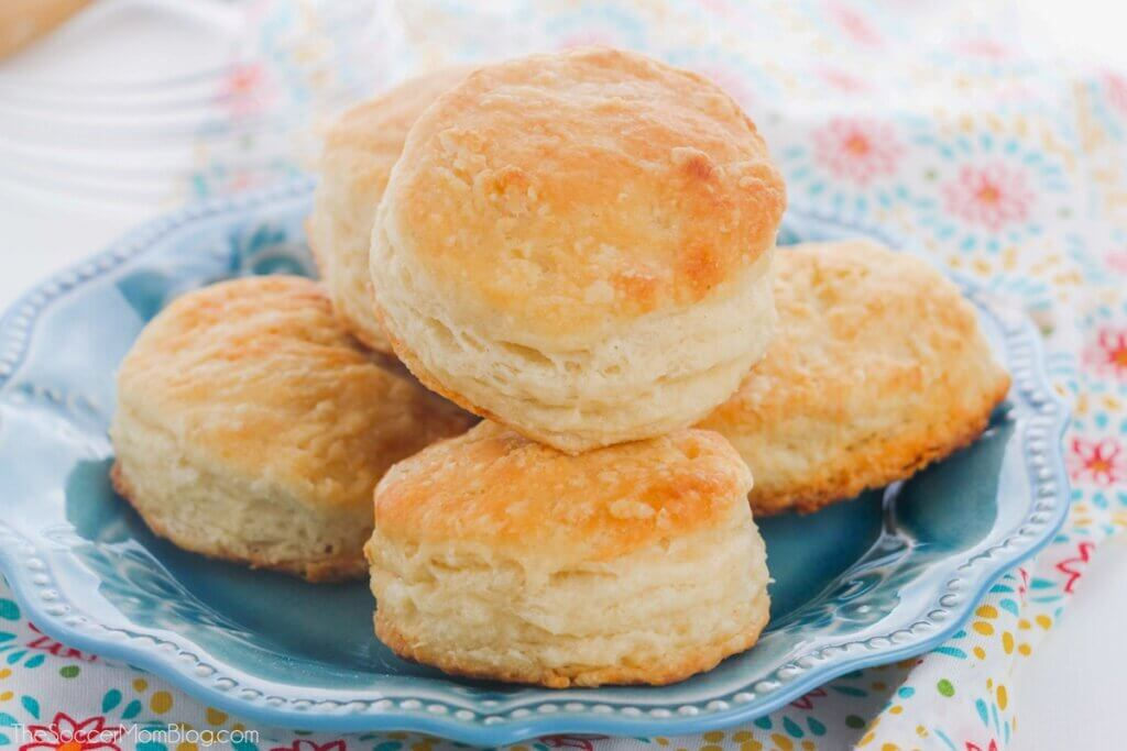 golden brown buttermilk biscuits on blue plate