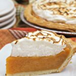 homemade sweet potato pie topped with toasted marshmallow meringue