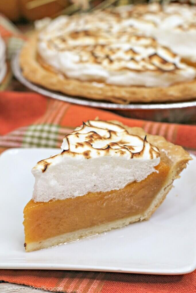 a slice of velvety sweet potato pie topped with roasted marshmallow meringue
