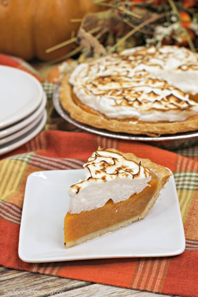 slice of sweet potato pie on napkins with pie in background