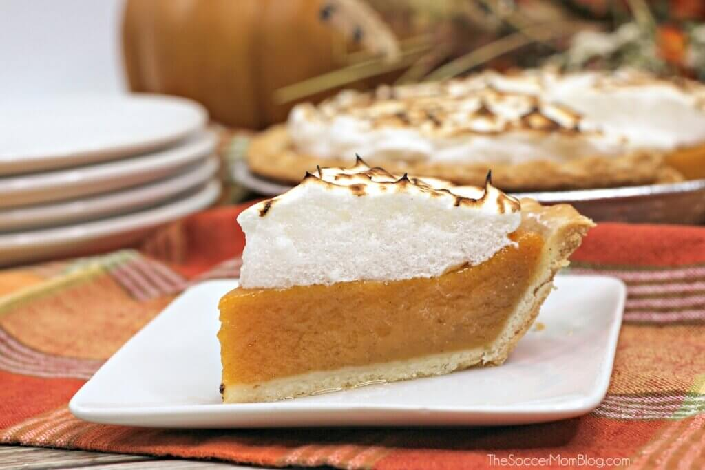 slice of sweet potato pie on plate, topped with meringue