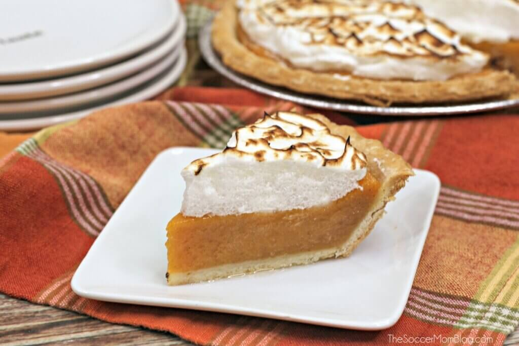homemade sweet potato pie with slice cut and served on plate