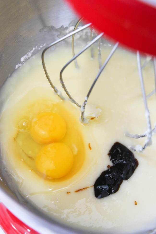 adding eggs to cookie batter