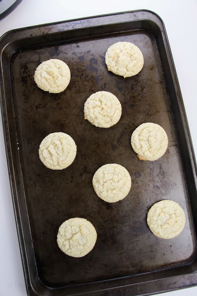 fresh baked sugar cookies on baking sheet