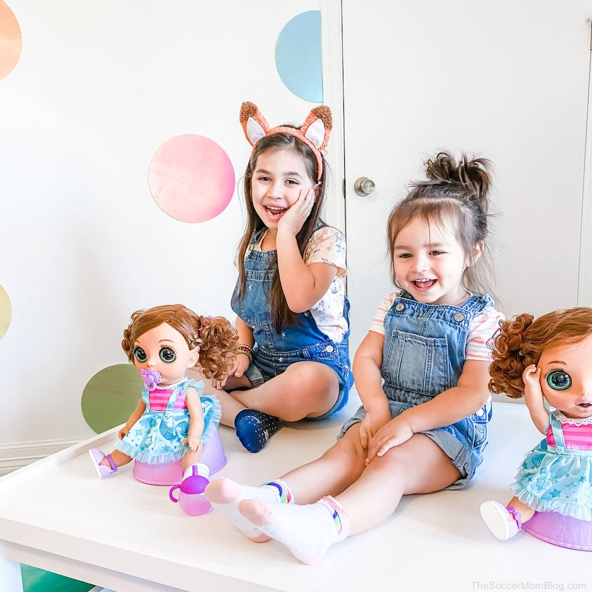 little girls playing with dolls