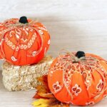 bandana pumpkins on straw bale