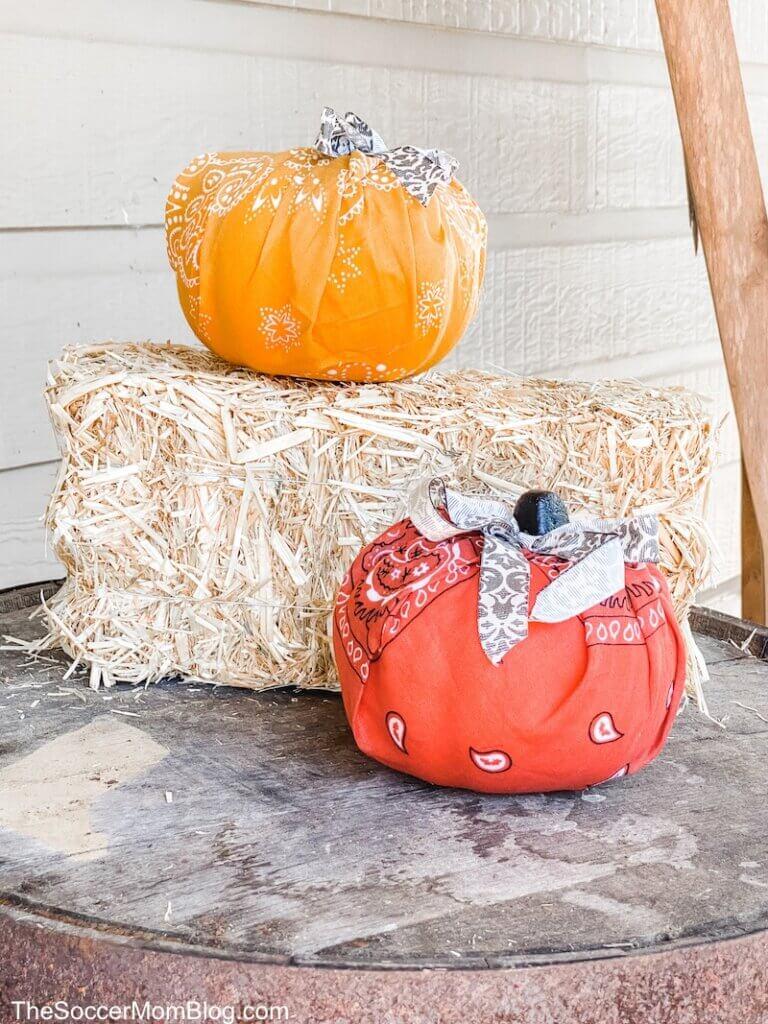 bandana pumpkins on farmhouse front porch