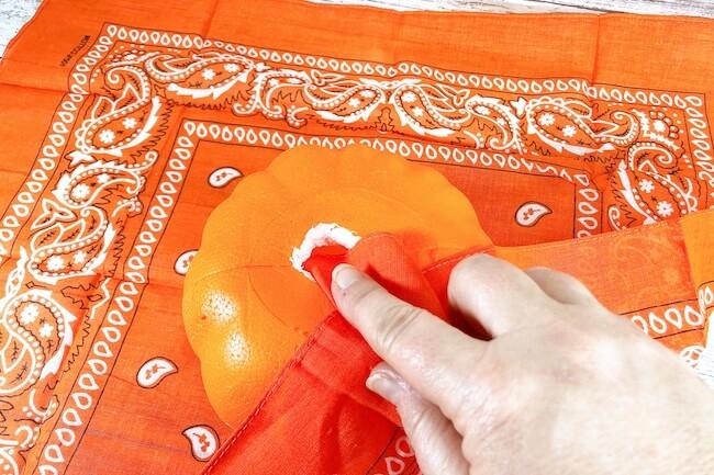 covering a foam craft pumpkin with a bandana