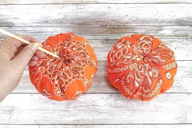 covering foam pumpkins with orange bandana