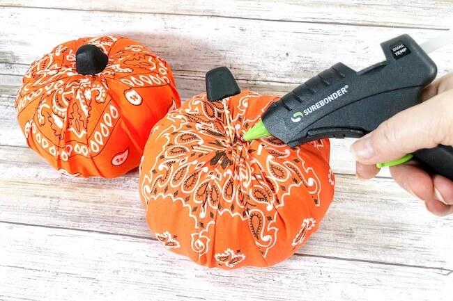 gluing stem on bandana pumpkin craft