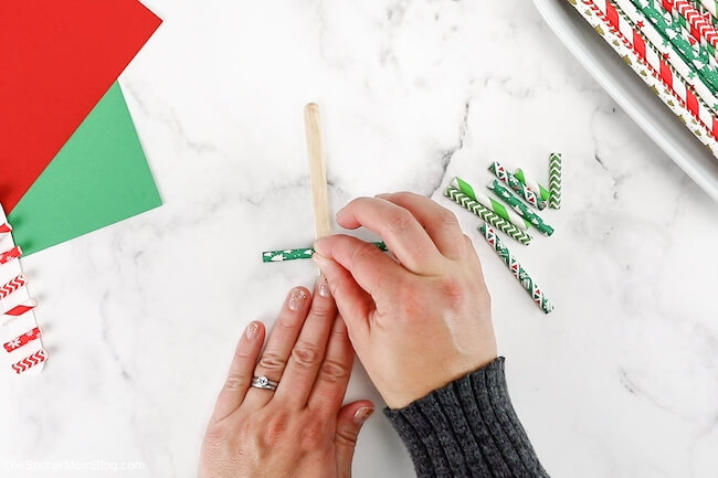 gluing paper straws to craft stick