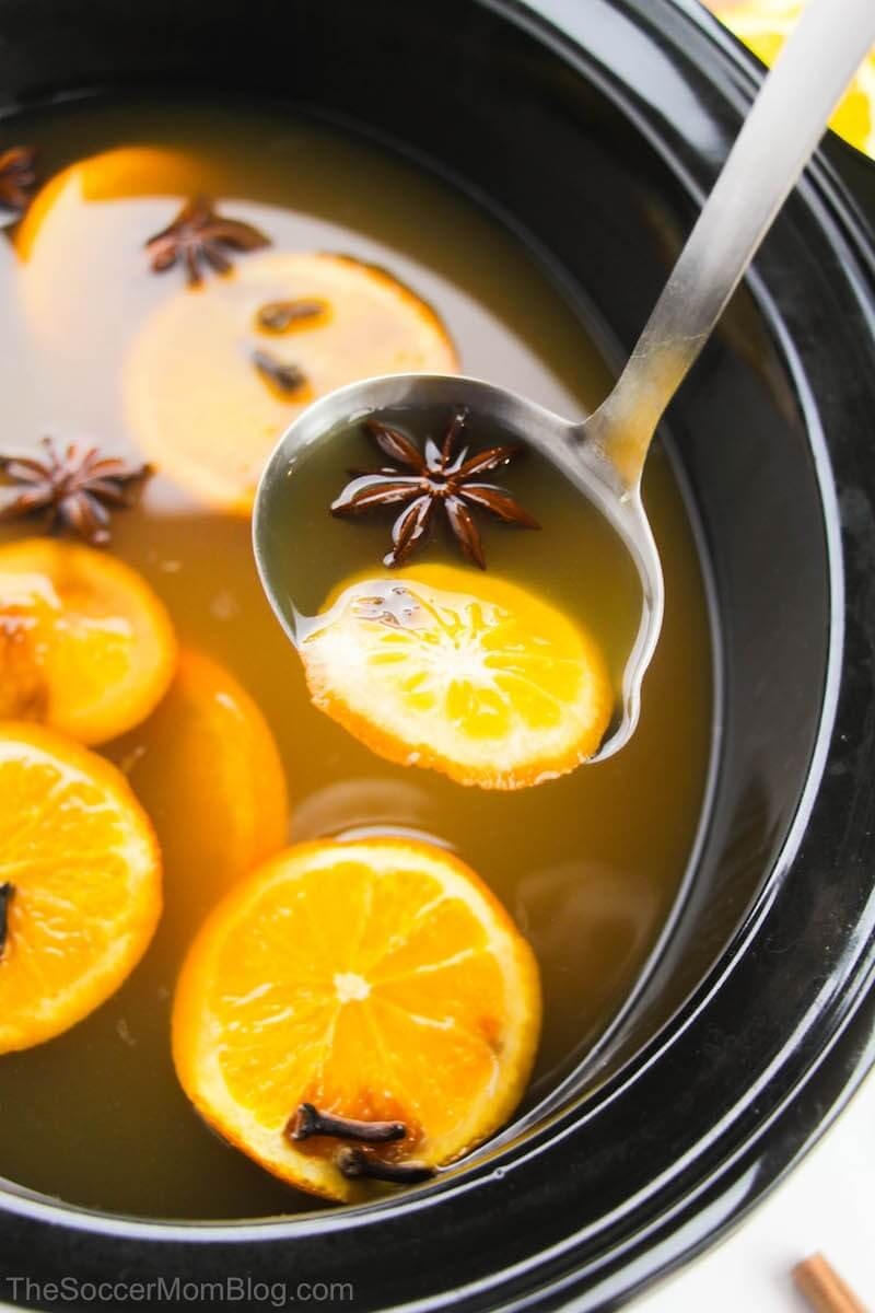 mulled apple cider ladled from slow cooker