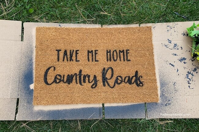 hand painted doormat drying outside