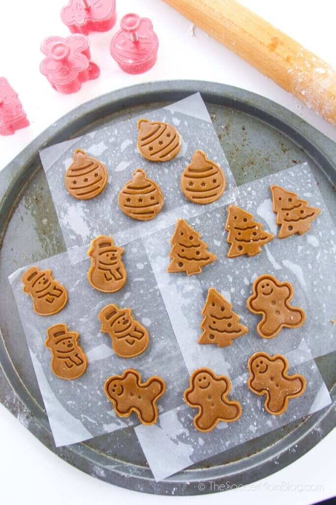 mini gingerbread cookies on baking sheet