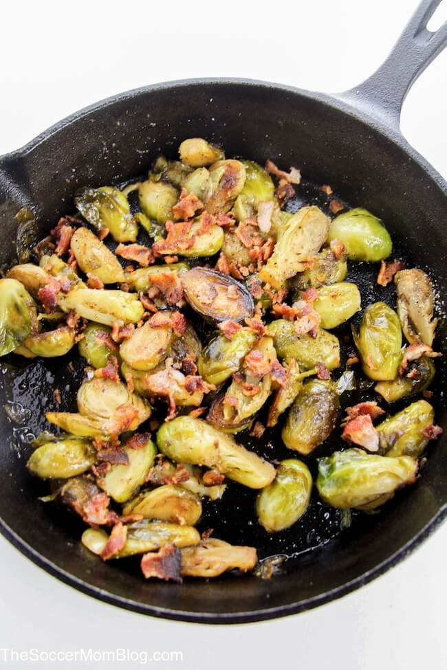 adding bacon to a skillet with brussel sprouts