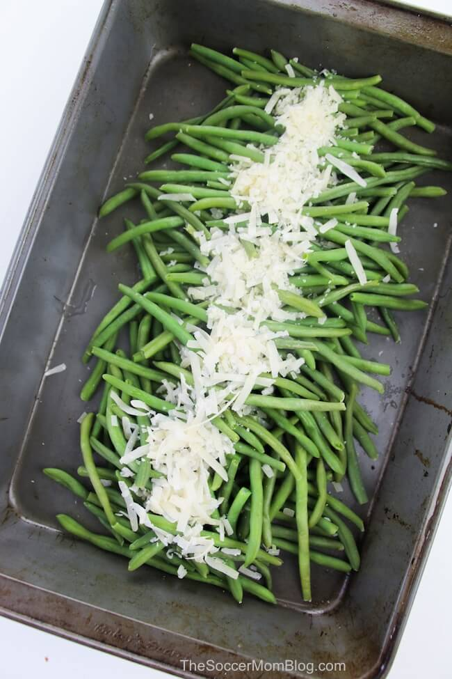 green beans in baking pan topped with shredded parmesan