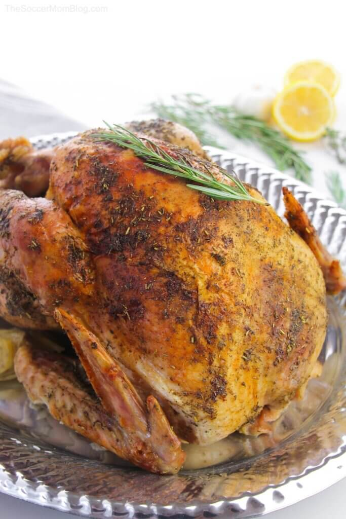 whole roasted turkey on silver platter