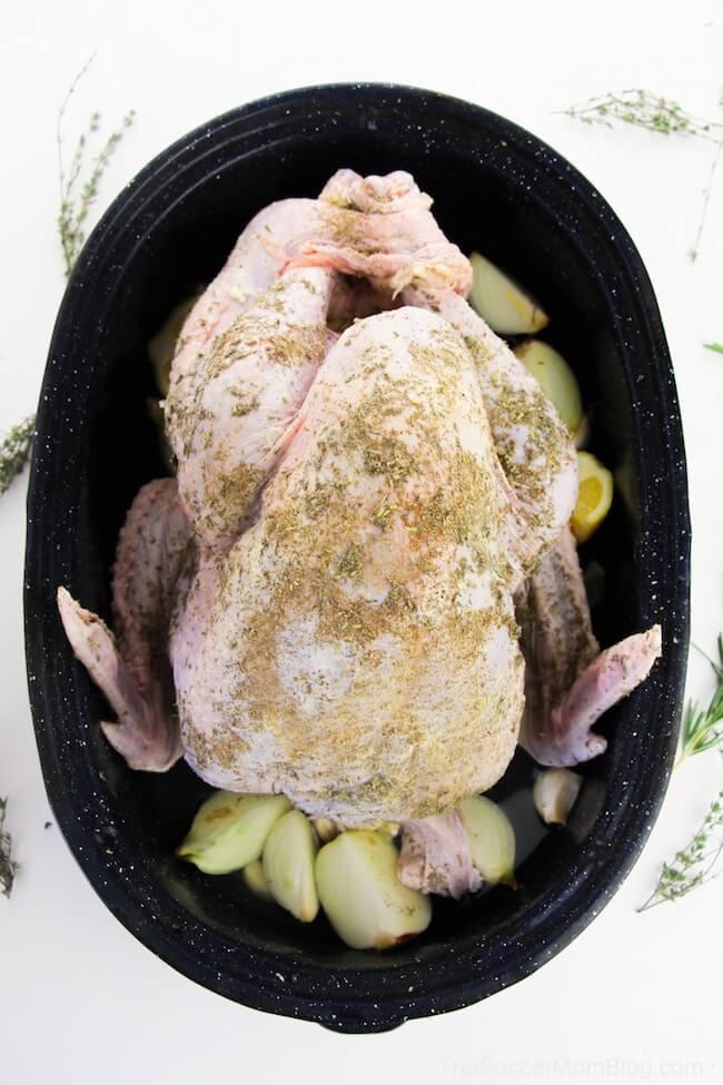 whole seasoning turkey ready to bake in roasting pan