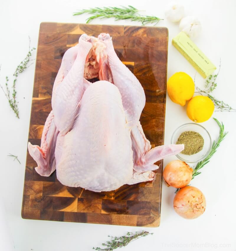 whole uncooked turkey on cutting board