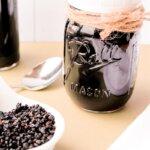 homemade elderberry syrup in mason jar