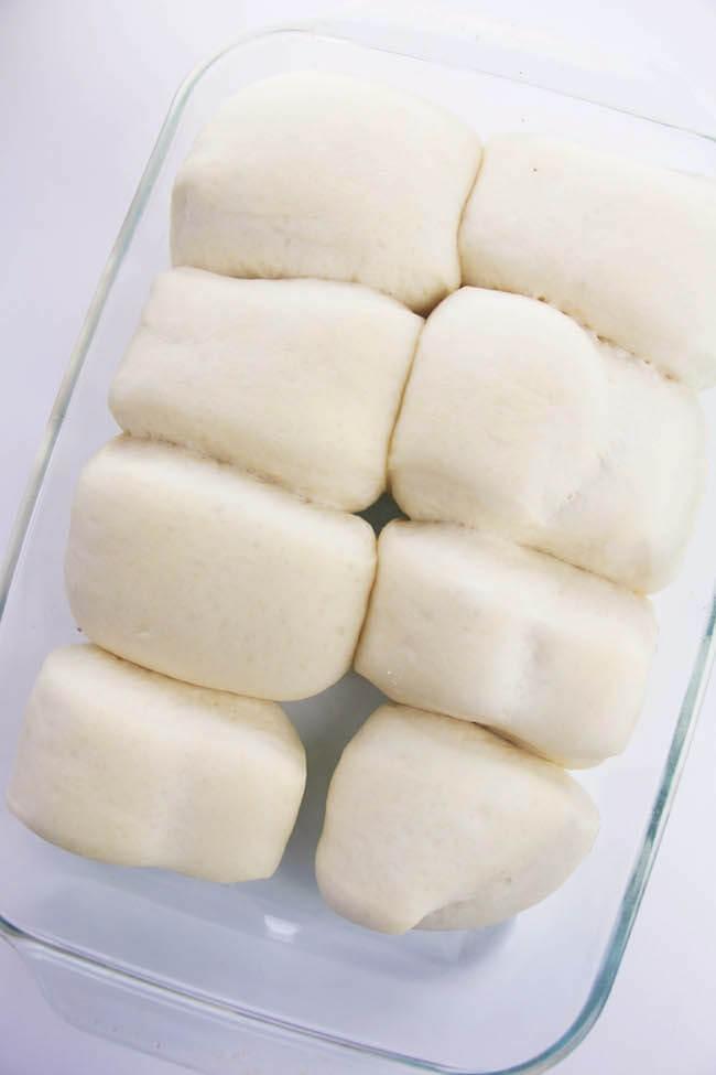 copycat Texas Roadhouse rolls rising in baking dish