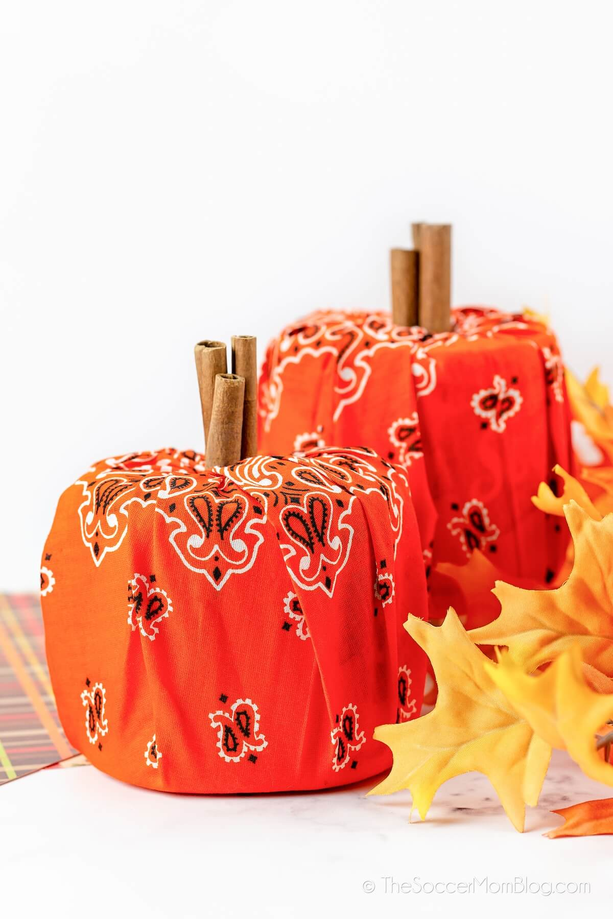 decorative pumpkins made from toilet paper rolls and bandanas